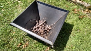 Start the fire using twigs and small kindling.